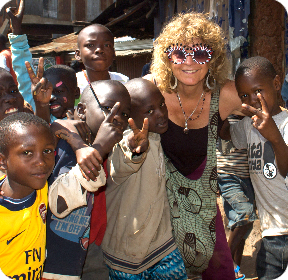 Founder Gloria Simoneaux Sharing DrawBridge book to street children in Africa photo